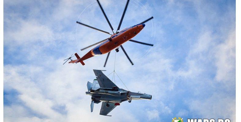 ВИДЕО: Ми-26 пренася 16-тонен тежък самолет, завързан на стоманени въжета
